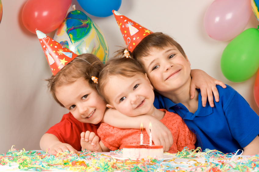 Three siblings are happily posing during birthday party
