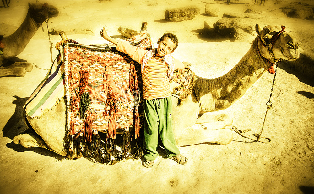 Kid Posing with his Camel in the Desert web 1000 n 72