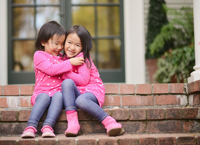 San-Francisco-Bay-Area-Peninsula-lifestyle-children-photography-sisters-tickling-on-the-stairs