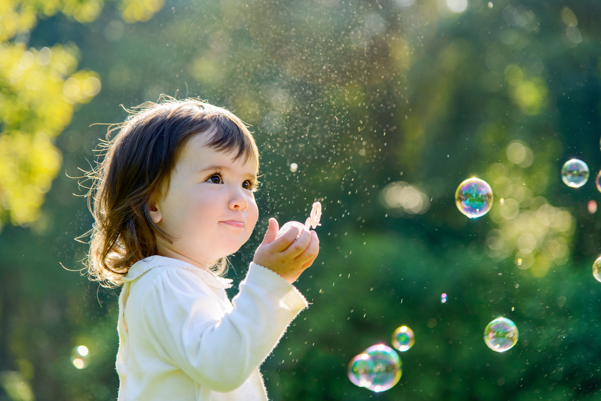baby-girl-playing-with-soap-bubbles-1