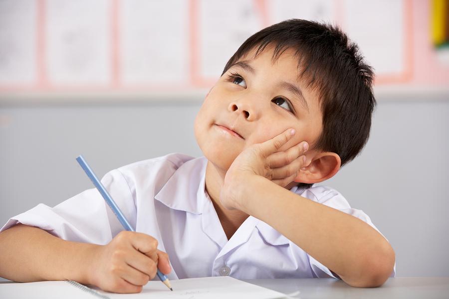 bigstock-Male-Student-Working-At-Desk-I-38771890